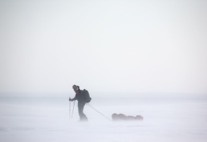 A single person on a winter expedition in a snow storm