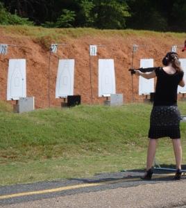 Liz shooting gun
